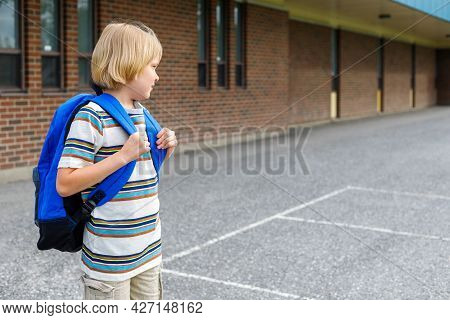 Little Schoolboy Going To School, Carrying Backpack. Back To School Concept.