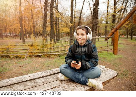 Happy Male Excited By Camping In The Park Enjoying Nature. Young Boy Enjoying Outdoor Activity. Adve
