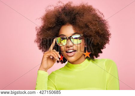 Beauty Portrait Of African American Girl In Colored Holographic Sunglasses. Beautiful Black Woman On
