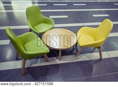 Mall Seating Of Three Chairs And A Low Table For Shoppers To Rest And Refresh