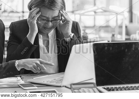 Asian Businesswoman Overworked At Office Stressful Anxiety With Serious Problems. Woman Exhaustion D