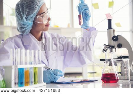 Closeup Woman Scientist Hand Use Dropper In Lab Look At Science Microscope Medical Test, Research Bi