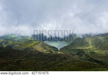 Deep lake in Flores Island, Azores Archipelago, Portugal. Green lagoon with green vegetation