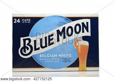 IRIVNE, CALIFORNIA - 17 JUL 2021: A 24 pack case of Blue Moon Belgian White Ale aluminum cans on white.