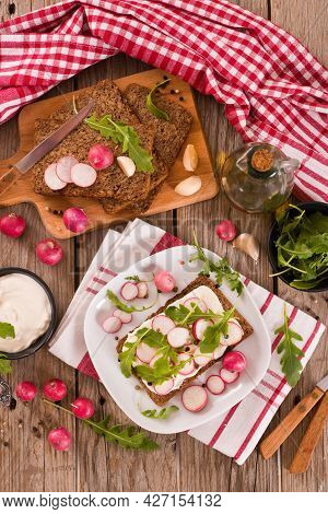Rye Bread With Cottage Cheese, Radish And Arugula.