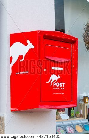 Gorlitz, Germany - June 2, 2021: Red Mail Box Belong To Post Modern In Germany.