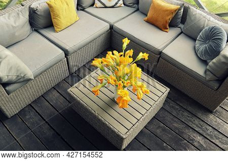 Outdoor Furniture Lounge Group With Chairs, Sofa And Table In A Patio. Seating On The Balcony, Is A