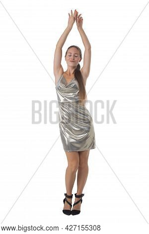 Stylish Young Blonde Woman Dancing In Silver Shiny Dress. Full Body Length Portrait Isolated On Whit