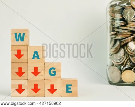 Finance Concept On White Background. Letters Wage On Wooden Cubes With Arrow Down Symbols.