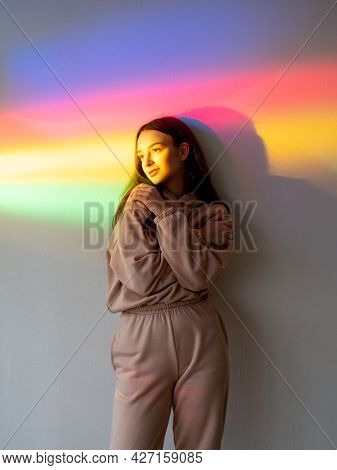 Color Light People. Self Love. Calm Energy. Feel Good. Peaceful Relaxed Girl Hugging Self On Smooth