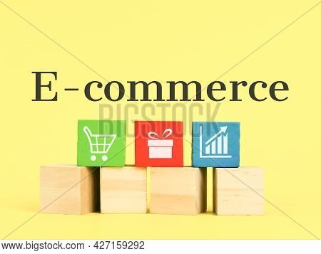 E-commerce Concept With Icons On Colorful Wooden Cubes. Business And Finance Concept.