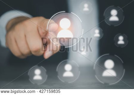Businessman Hand Choosing One People Icon From Many People Icons. The Concept Of Human Resources Con