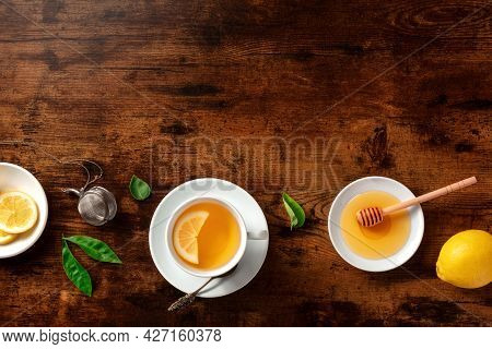 Tea With Lemons And Honey, Shot From The Top On A Rustic Background With Copy Space. Healthy Organic