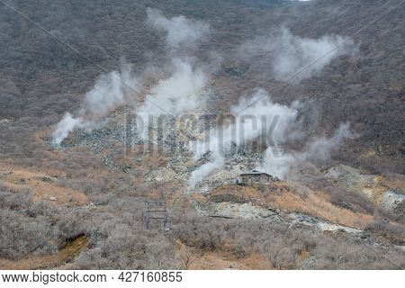 Small House Set Up On Mount  In Kami Mountain With Smoky Surrounding Area,owakudani Hell Valley Hako