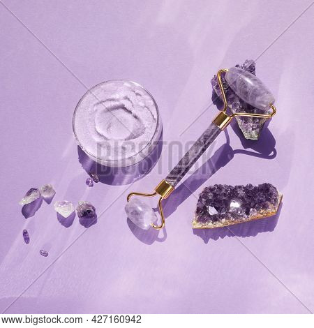 Amethyst Crystals Gua Sha Roller Massage Scraper And Beauty Product. Moisturizer And Skincare Tools.