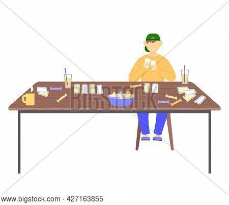 Boy Teenager Sitting At Table With Drinks And Candy Holding Cards Piece Of Paper. Kid Dressed In Cas