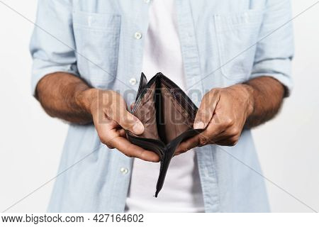 Close Up Of Man Hands Holding And Empty Wallet On White Background. Financial Crisis, Bankruptcy, No