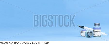 Covid Vaccine Bottle With Syringe On A Light Blue Background 2