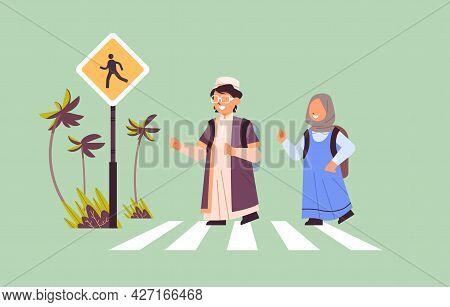 Arab Schoolchildren Crossing Road On Crosswalk With Signboard Road Safety Concept Horizontal