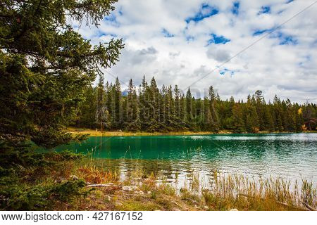 Annette Lake - lovely lake with cold green water. Magnificent landscape in Jasper Park. The Rocky Mountains of Canada. Indian summer. Travel and photo tourism concept