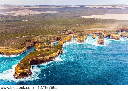 Scenic coastline. Picture taken from a helicopter. Australia, Port Campbell Park. Great Ocean Road and the Twelve Apostles is a group of limestone cliffs. The concept of extreme, active  tourism