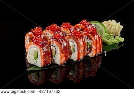 Philadelphia Rolls With Salmon, Red Caviar, Cream Cheese, Avocado And Unagi Sauce