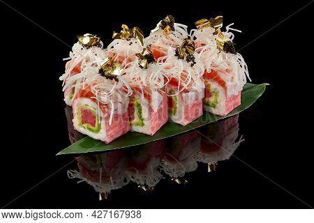Sushi Rolls With Salmon And Tuna In Mamenori With Daikon, Tobiko And Edible Gold