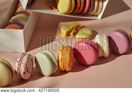 Assorted Macarons Taken Out Of Boxes And Lined Up