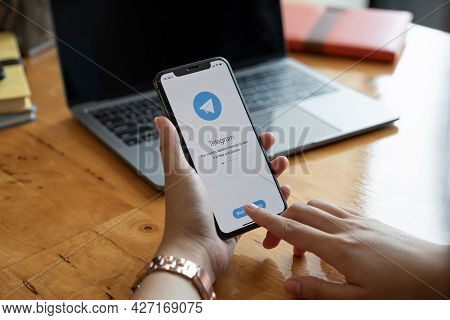 Chiang Mai, Thailand, Jan 23, 2021 : Woman Hand Holding Iphone 12 With Social Networking Service Tel