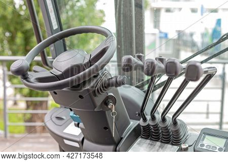 Forklift Truck Steering Wheel And Levers Commands In Cabin