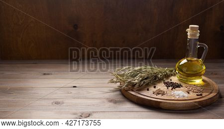 Pizza cutting board and food ingredient with spice for homemade bread cooking or baking on table. Pizza board at wooden tabletop background. Bakery concept in kitchen