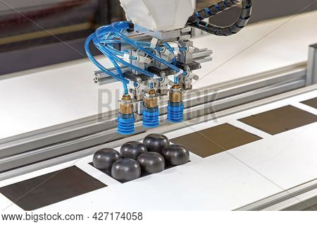 Automatic Arm With Vacuum Suction Picking At Conveyor Belt