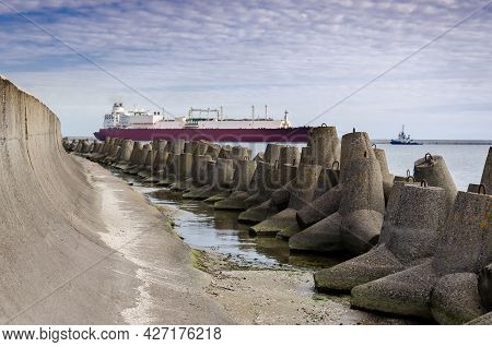 Dolos And Lng Tanker - Ship Against Background Of Concrete Protection Of The Seaport And Sea Coast