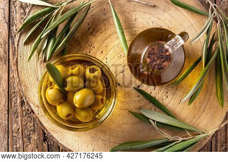 Virgin Olive With Green Olives In Crystal Bowl On Wooden Table.top View
