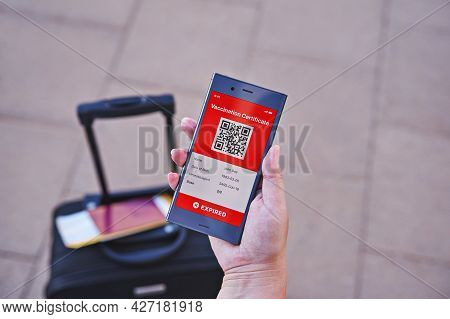 Smartphone In Hand Displaying On App Mobile Expired Digital Green Vaccination Certificate For Covid-