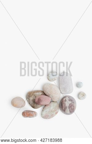 Marble zen stones stacked on white background in mindfulness concept