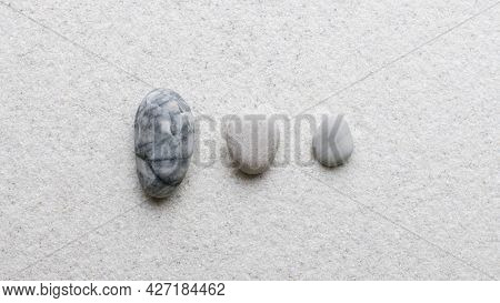 Marble zen stones stacked on white background in stability concept