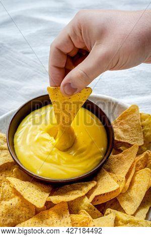 Tex mex corn tortilla chips with cheddar cheese dip