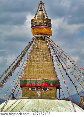 Man Cleaning The Holy Stupa At Boudhanath, Kathmandu, Nepal