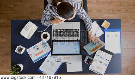 Top View Of Businesswoman Discussing With Manager Explaining Company Statistics Using Landline While