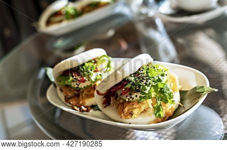 Vegan Bao Sandwich With Tofu And Kimchee In A Cafe