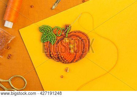 Diy Present For Halloween And Thanksgiving Day. Handmade Beaded Pumpkin. Jewelry Designer Making Bro