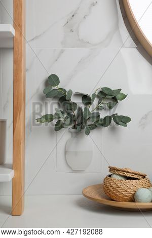 Silicone Vase With Eucalyptus Branches On White Marble Wall Over Countertop In Stylish Bathroom