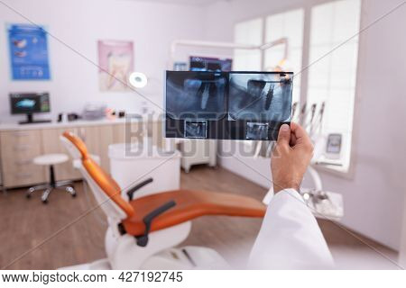 Orthodontist Doctor Holding Medical Teeth Jaw Radiography Examining Dental Oral Healthcare Working I