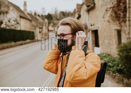 Man wearing mask in the new normal village