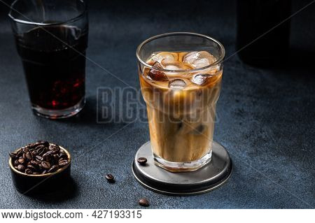 Ice Coffee In A Tall Glass With Cream Poured Over. Almond Milk Latte. Cold Summer Drink. Cold Brew I