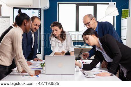 Multiethnic Businesspeople Meeting Brainstorming, Team Leader Sharing Creative Ideas Planning. Multi