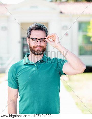 Mature Teacher Nerd Looking Smart. Smiling Unshaven Man Look Through Eyeglasses.