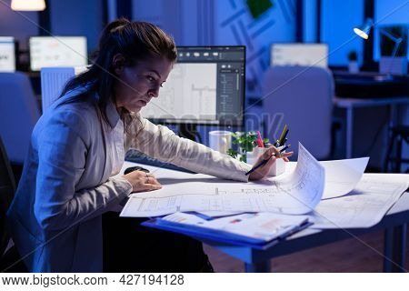 Over The Shoulder Shot Of Engineer Woman Drawing Architectural Plans And Looking At Cad Software On