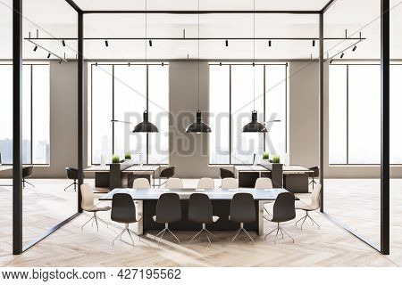 Front View On Meeting Table In Conference Room With Glass Walls In Spacious Sunny Office Hall With M